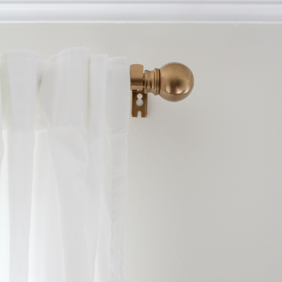 An Easy Curtain Rod Update – Outdated to Brass Beauty